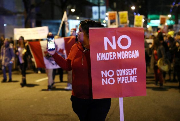 Protesters gather to voice their opposition to Canada's decision to approve Kinder Morgan's pipeline from the Alberta oil sands to the Pacific coast in Vancouver, B.C., Nov. 29, 2016.