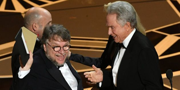 Director Guillermo del Toro (L) accepts Best Picture for 'The Shape of Water' from actor Warren Beatty onstage during the 90th Annual Academy Awards on March 4, 2018.