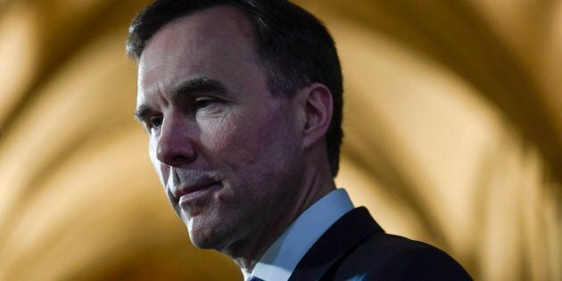 Finance Minister Bill Morneau participates in a TV interview after tabling the budget in the House of...