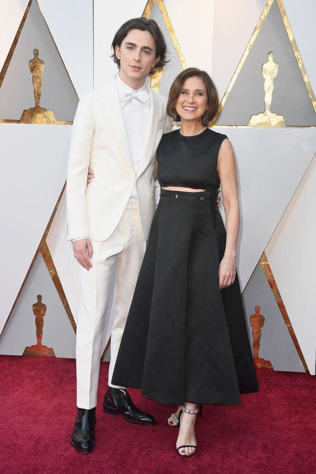 Timothee Chalamet and his mom, Nicole Flender, pose on the Oscars red