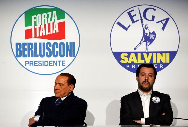Forza Italia leader Silvio Berlusconi sits next to Northern League leader Matteo Salvini during a meeting...