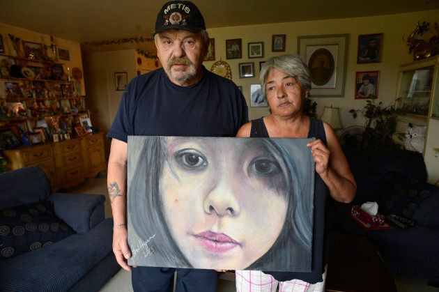 Joe and Thelma Favel hold a framed collage tribute to their niece, Tina Fontaine, who was