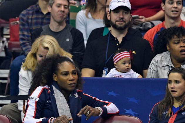 Serena Williams bottom left, along with her husband Alexis Ohanian and their daughter Alexis Olympia, center, at the 2018 Fed Cup at US Cellular Center on February 10, 2018.