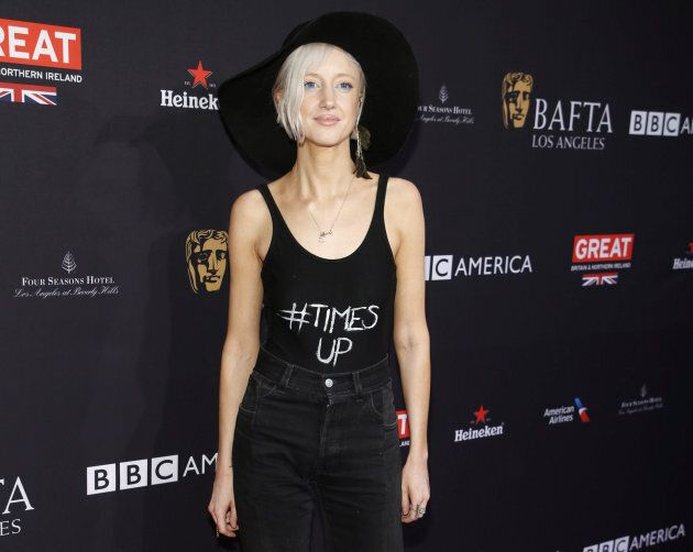 Actor Andrea Riseborough poses with a hashtag on her shirt, #TimesUp, at the BAFTA Los Angeles Awards Season Tea Party in Los Angeles.