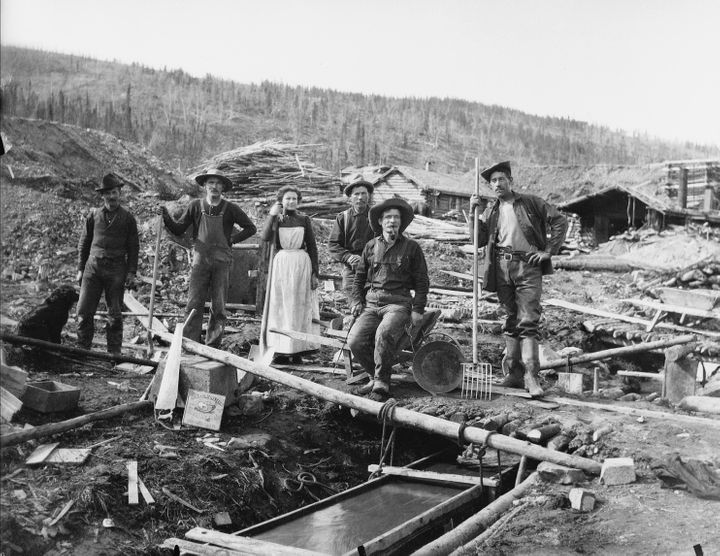 A group of unidentified people sluice for gold during the Klondike gold rush.
