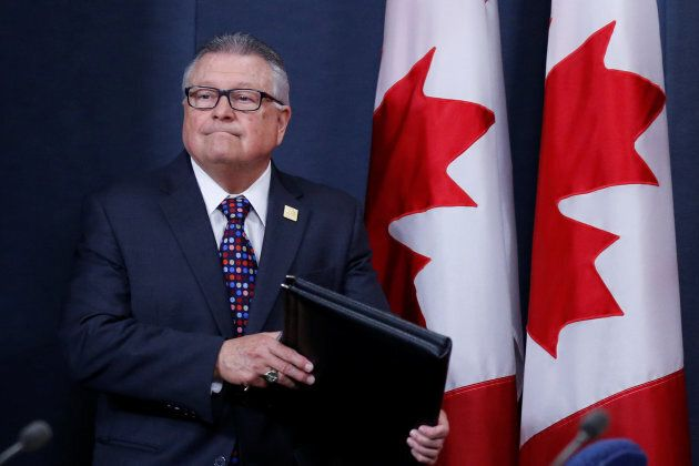 Public Safety Minister Ralph Goodale arrives at a news conference in Ottawa on June 20,