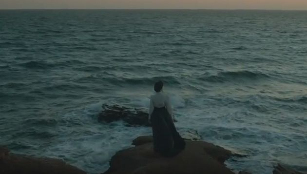 An actor portraying Lucy Maud Montgomery looks out over the ocean in a new Historica Canada Heritage