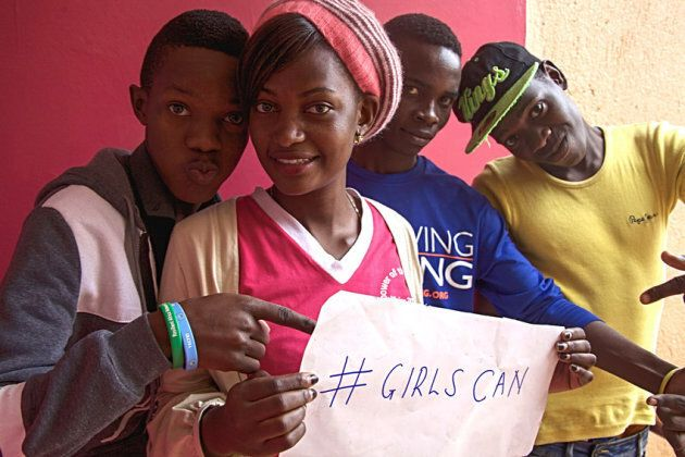 Young people in Uganda participate in a youth club which promotes girls' rights.