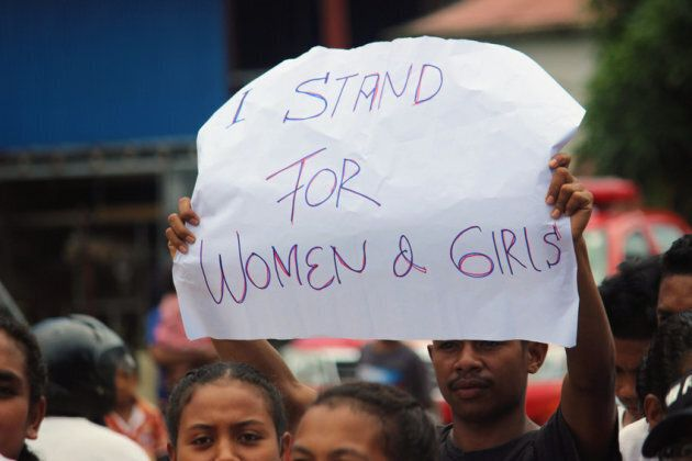 A group of youth activists in Timor Leste protest violence against women and