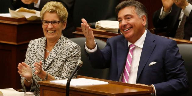 Ontario Finance Minister Charles Sousa and Ontario Premier Kathleen Wynne prepare to deliver the provincial...