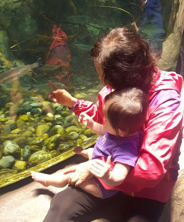 My mom and my daughter watching the fish.