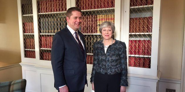 Conservative Leader Andrew Scheer smiles for a photo with British Prime Minister Theresa May in a photo...