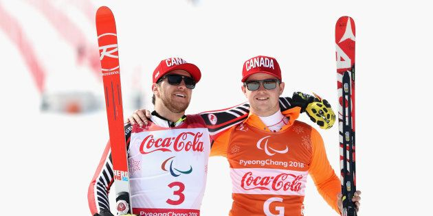 Mac Marcoux, left, and guide Jack Leitch, right, won the gold medal in Men's downhill for visually impaired...