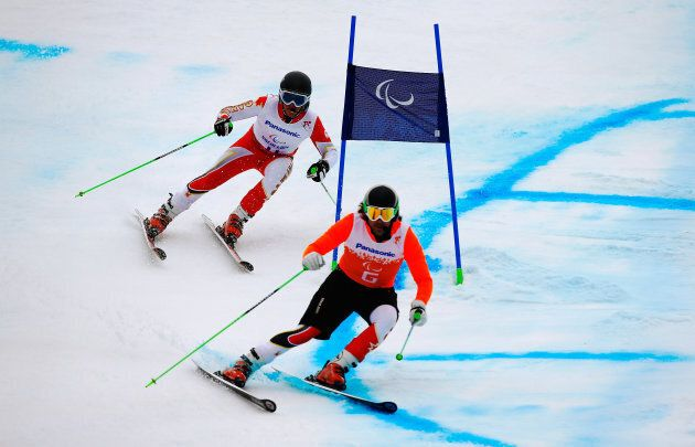 Mac Marcoux and guide Robin Femy compete in the Men's Giant Slalom Visually Impaired at the Sochi 2014...