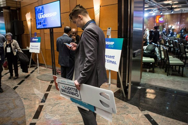 A Christine Elliott supporter leaves the convention hall.