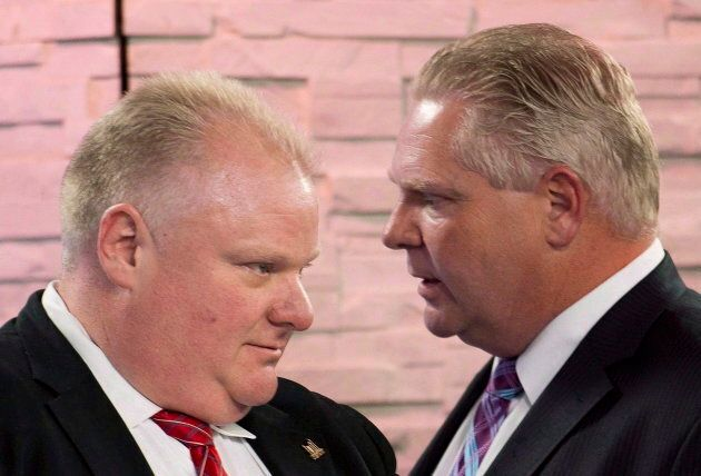 Doug Ford speaks to his late brother Rob during a break as Rob took part in a mayoral debate in Toronto...
