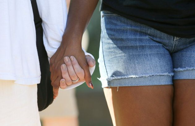 Activists join hands during a Black Lives Matter rally in Charleston, West Virginia, U.S., on Aug. 20,