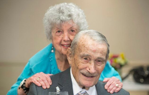 100 year old Edward Sohmer gets a hug from a friend during an event to celebrate twenty centenarians who live at the Waldorf Residence in Montreal, March 11, 2018.
