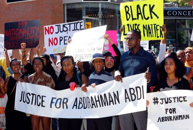 People assemble to honour Abdirahman Abdi in a protest at Ottawa's police headquarters on July 30,
