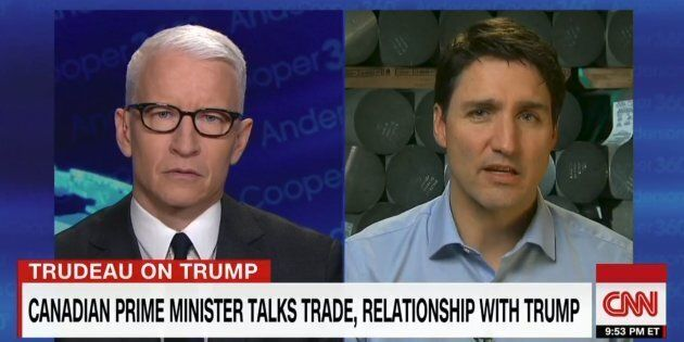 Anderson Cooper and Prime Minister Justin Trudeau are shown in a screegrab