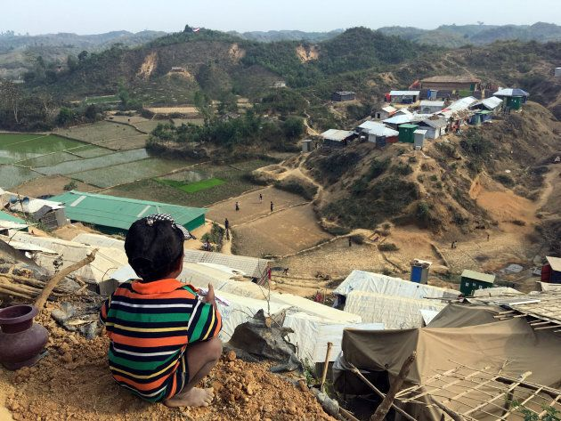A boy sits on a a hillside in the Chakmakul camp for Rohingya refugees in southern Bangladesh, Feb. 8,