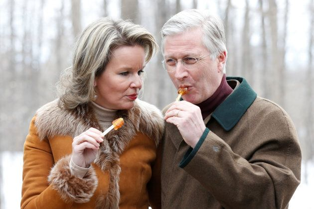 Belgium's King Philippe and Queen Mathilde eat maple taffy at the Richelieu Park sugar shack in Ottawa...