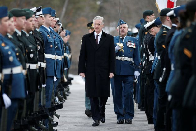 Belgium's King Philippe inspects the honour guard during an official welcome ceremony at Rideau Hall...