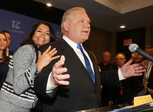 Progressive Conservatives leadership race candidate winner Doug Ford speaks with his wife Karla in Markham, Ontario, on March 10, 2018.
