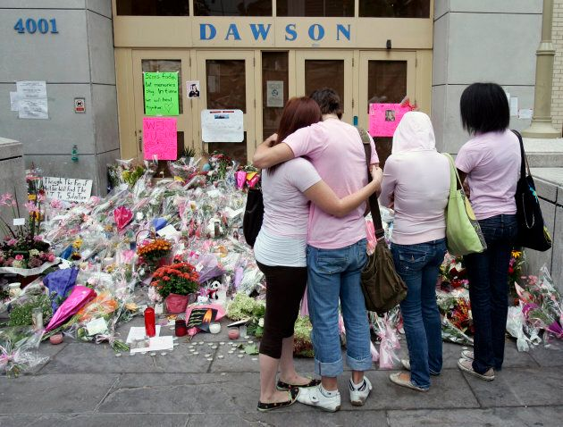 Students of Dawson College hug as they prepare to return to the school in Montreal, Sept. 18, 2006 for...