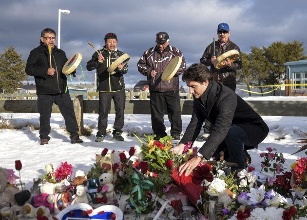 Prime Minister Justin Trudeau lays a wreath at a memorial during a visit to the town of La Loche, Sask....