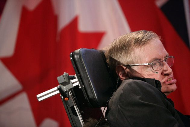Renowned physicist Stephen Hawking poses for photographs following a lecture at the Perimeter Institute...