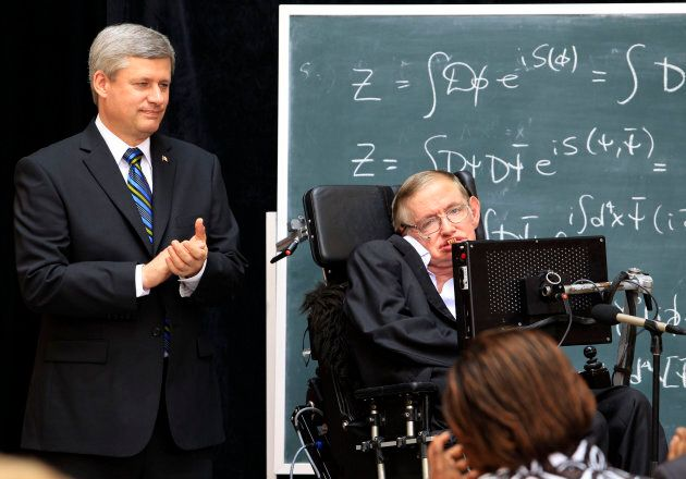 Former Prime Minister Stephen Harper applauds beside British physicist Stephen Hawking after making an...
