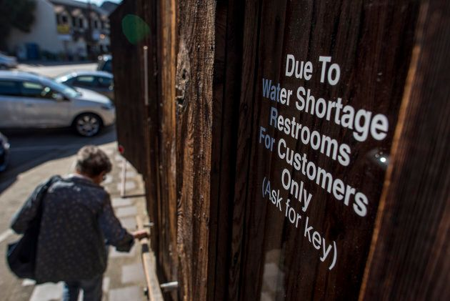 A sign in the window of a restaurant in Cambria, California, on April 12,