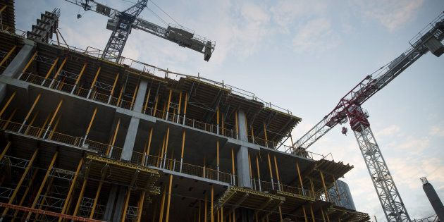A condominium under construction in Toronto is shown on May 27, 2017. Canada will see falling house prices and sales this year, led by Toronto and Vancouver, according to a new forecast from the country's leading real estate group.