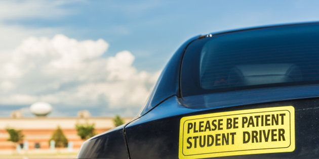 Student driver sign with blue sky