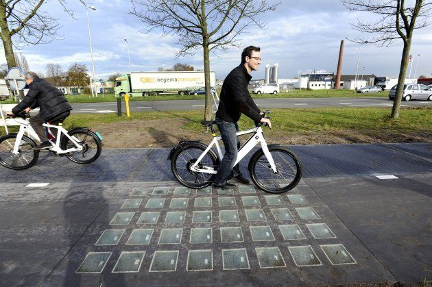 Cyclists use the SolaRoad, the first road in the world made of solar panels.