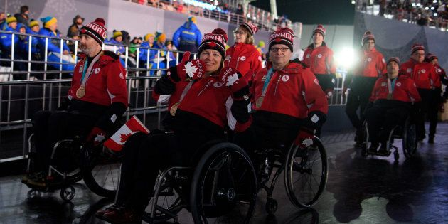 Team Canada enters the stadium during the Closing Ceremony for The Paralympic Winter Games in the PyeongChang...