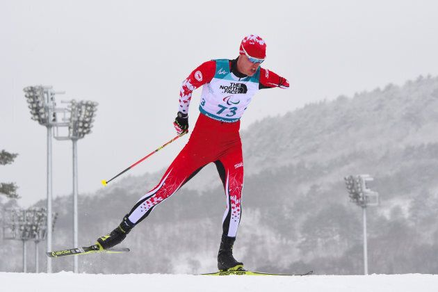 Mark Arendz of Canada competes in the men's 15km standing biathlon event at the Alpensia Biathlon Centre...