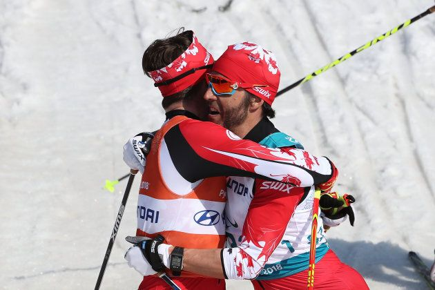 Brian McKeever of Canada celebrates with his guide Russell Kennedy after winning the Cross-Country Skiing...