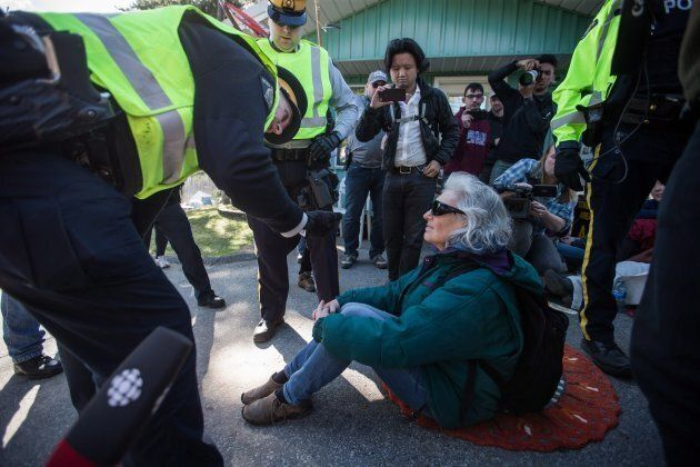RCMP officers arrest a protester outside Kinder Morgan in Burnaby, B.C., on March 17,