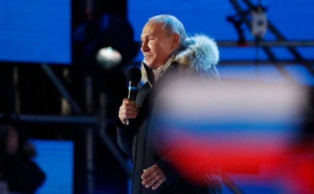 Russian President Vladimir Putin delivers a speech during a rally and concert marking the fourth anniversary...