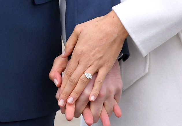 Prince Harry and Meghan Markle hold hands at an official photocall to announce their engagement in