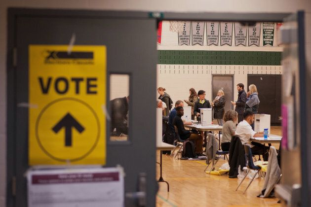 Voters cast ballots on election day in Toronto on Oct. 19,