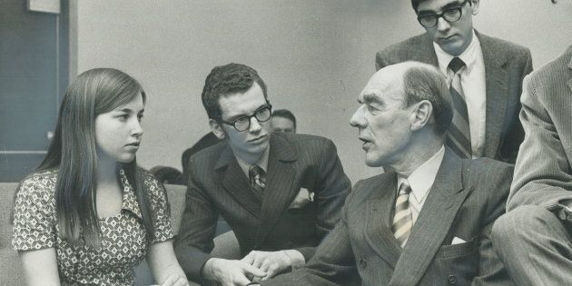 Opposition leader Robert Stanfield sits with Sally Caldwell, 18, David Armstrong, 18, and Gary Nicoll, 18, after speaking at York Mills Collegiate on April 6, 1970. Stanfield got a standing ovation after telling 1,200 students he believed the federal voting age would be lowered before the next election.