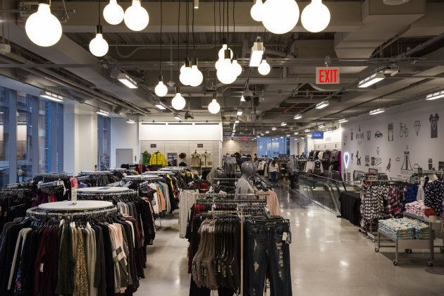Women's clothing is displayed for sale inside a Nordstrom Rack store ahead of the grand opening in the...