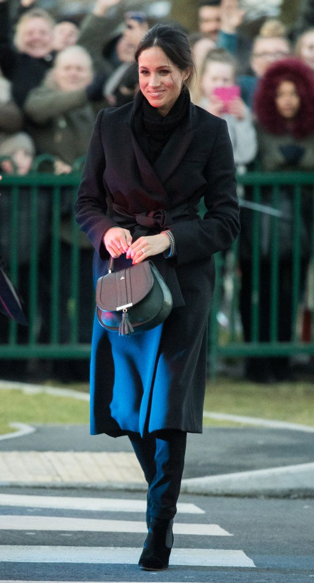 Meghan Markle wears a Stella McCartney coat while visiting Cardiff Castle, Wales, on Jan. 18,