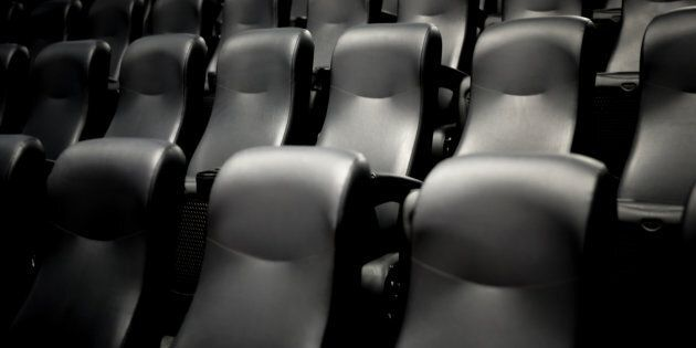 Empty movie theatre seats. A British movie chain is investigating the death of a moviegoer who reportedly...