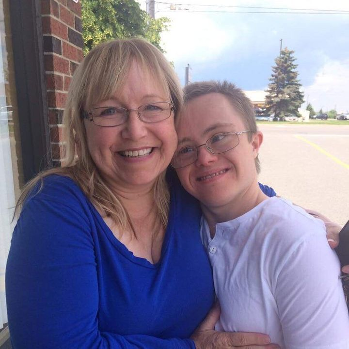 """Today, Joshua MacDonald (right) is 21. His mother Karen (left) says he's """"strong as an ox."""""""