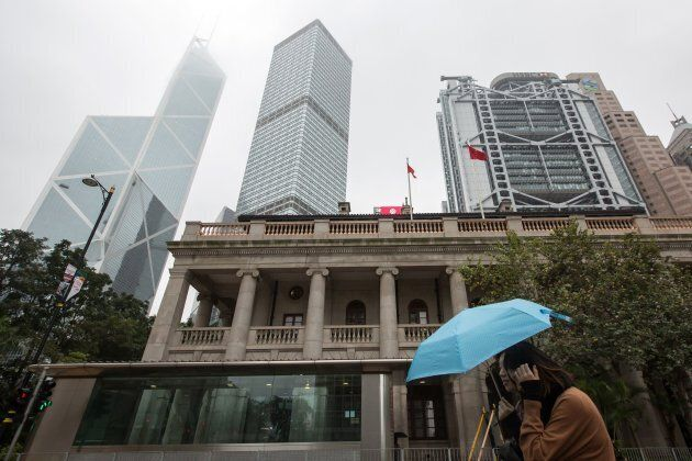This picture taken on Jan. 6, 2018 shows a pedestrian walking past the Hong Kong Court of Final Appeal...