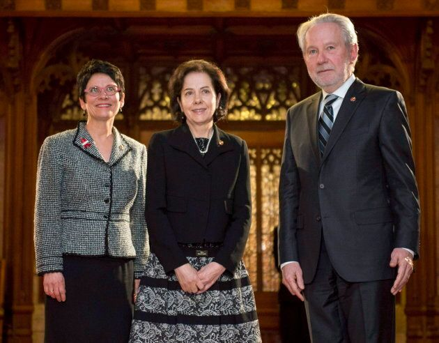 Raymonde Saint-Germain (centre) stands with Senators Raymonde Gagne (left) and Peter Harder before being sworn into the Senate, on Parliament Hill on Dec. 1, 2016 in Ottawa.